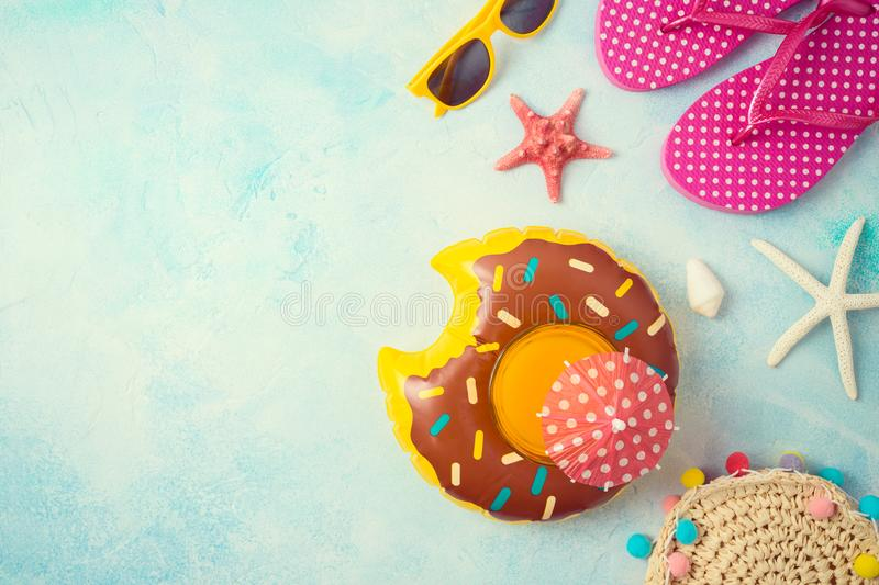 Summer holiday vacation background with orange juice and beach accessories. Top view from above royalty free stock photo