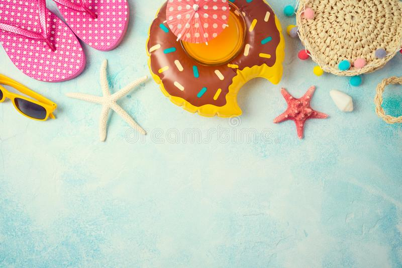 Summer holiday vacation background with orange juice and beach accessories. Top view from above stock photo