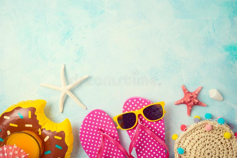 Summer holiday vacation background with orange juice and beach accessories. Top view from above royalty free stock photography