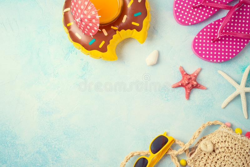 Summer holiday vacation background with orange juice and beach accessories. Top view from above. Summer holiday vacation background with orange juice and beach stock photos