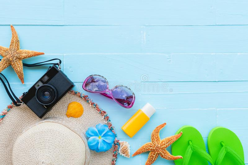 Summer holiday and vacation concept. Beach accessories including sunglasses, starfish, hat beach, sunblock, colorful flip flop and shell on bright blue pastel royalty free stock photos