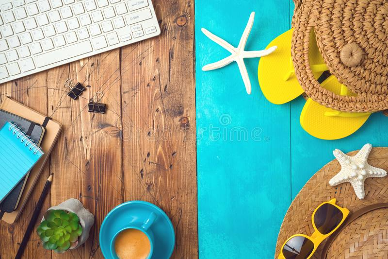 Summer holiday vacation concept with beach accessories and office desk background. Top view from above stock photo