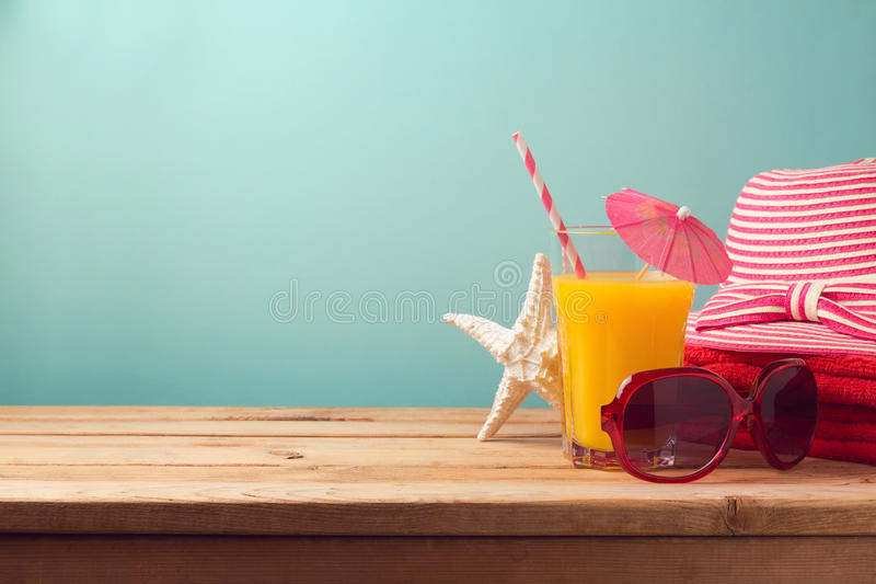 Summer holiday vacation concept with orange juice and beach items royalty free stock images