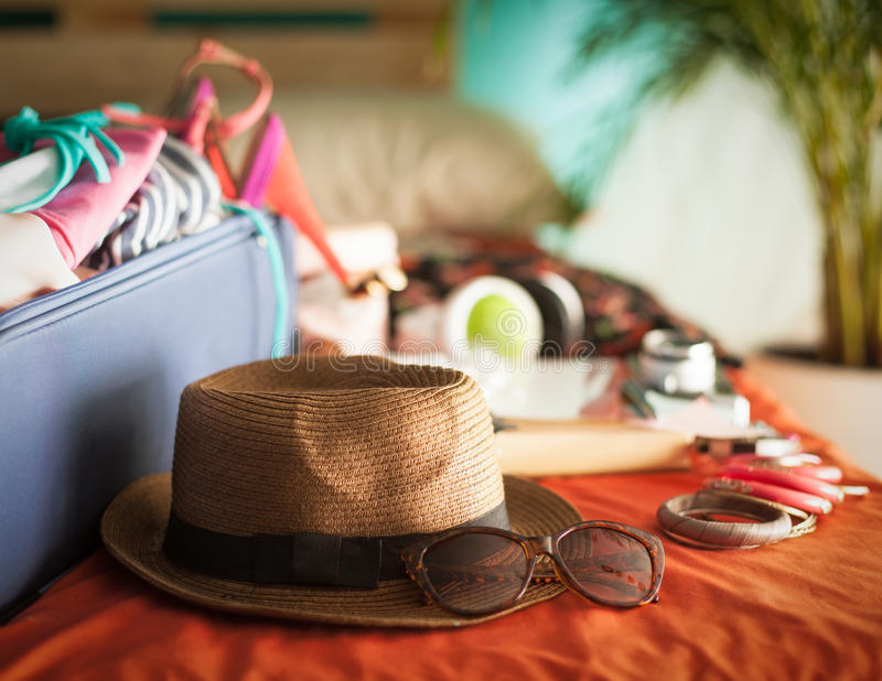 Summer Holiday. Woman's bedroom full of things ready to be taken on summer holiday royalty free stock photography
