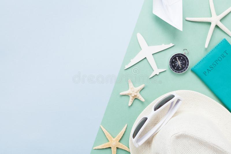 Summer holidays background from travel supplies on pastel paper top view. Flat lay style. royalty free stock photography