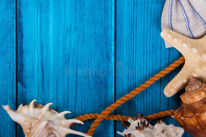 Summer holidays blue background with space for advertising and maritime theme. (seashells, starfish, sea knots, anchor, bow tie stock photos