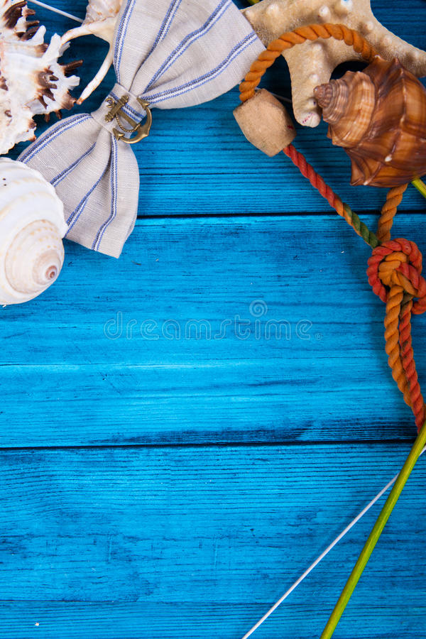 Summer holidays blue background with space for advertising and maritime theme. (seashells, starfish, sea knots, anchor, bow tie stock photography