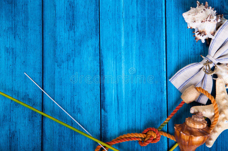 Summer holidays blue background with space for advertising and maritime theme. (seashells, starfish, sea knots, anchor, bow tie stock image