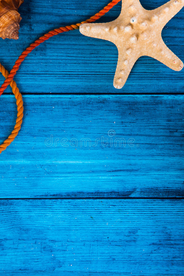 Summer holidays blue background with space for advertising and maritime theme. (seashells, starfish, sea knots, anchor, bow tie stock images