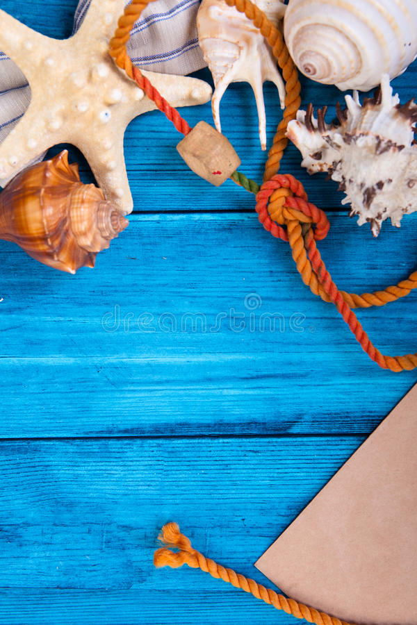Summer holidays blue background with space for advertising and maritime theme. (seashells, starfish, sea knots, anchor, bow tie stock photo