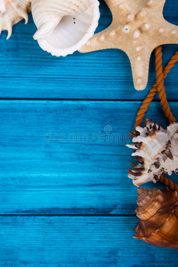 Summer holidays blue background with space for advertising and maritime theme. (seashells, starfish, sea knots, anchor, bow tie royalty free stock photography