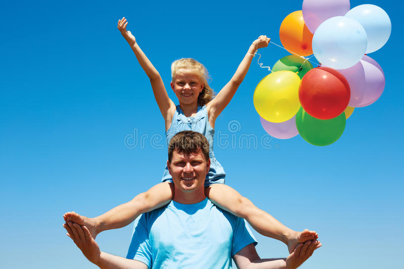 summer holidays, celebration, children and people concept - family with colorful balloons stock image