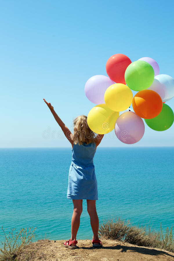 summer holidays, celebration, family, children and people concept - happy girl with colorful balloons stock photos
