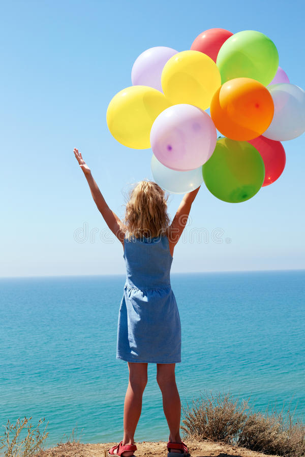summer holidays, celebration, family, children and people concept - happy girl with colorful balloons royalty free stock photo