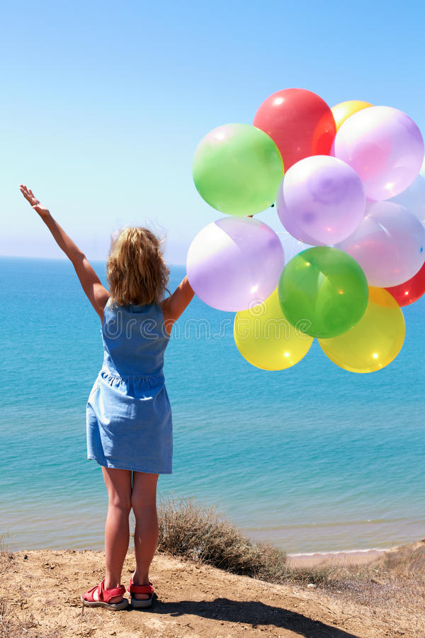 summer holidays, celebration, family, children and people concept - happy girl with colorful balloons royalty free stock images