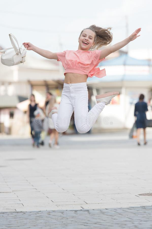Summer holidays. Charming stylish fashionable girl. Little child enjoy walk. Happy day. Enjoy being teen. Weekend walk. Girl carefree child. Only fun on my stock photo