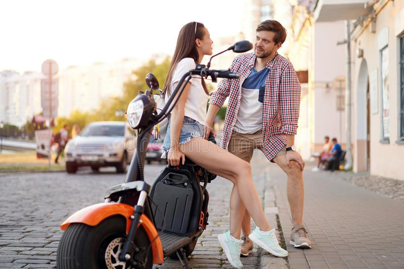 Summer holidays, love, travel, tourism, relationship and dating concept - romantic happy couple hugging in the street. stock photos