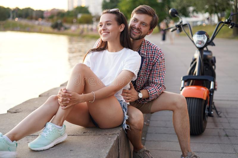 Summer holidays, love, travel, tourism, relationship and dating concept - romantic happy couple hugging in the street. royalty free stock photography