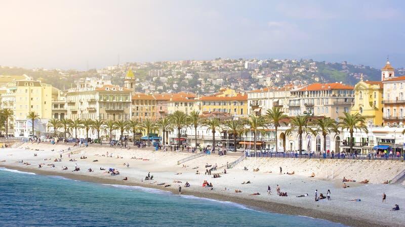Summer holidays in Nice, people sunbathing on summer beach, sunny resort city. Stock photo stock images