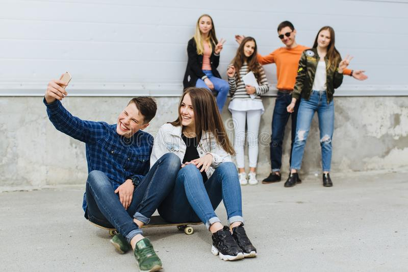 Summer holidays and teenage concept - group of smiling teenagers stock photo