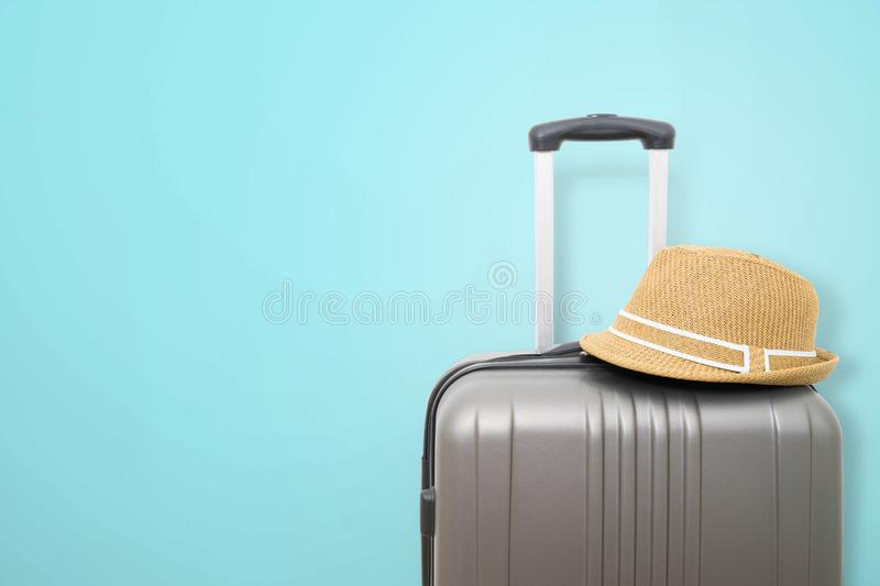 Summer holidays travel concept suitcase or luggage bag. With hat royalty free stock photography