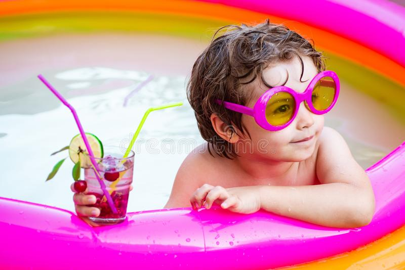 Summer holidays and vacation concept. Stylish sunglasses. Summer vacation and travel. Children play in tropical resort royalty free stock image