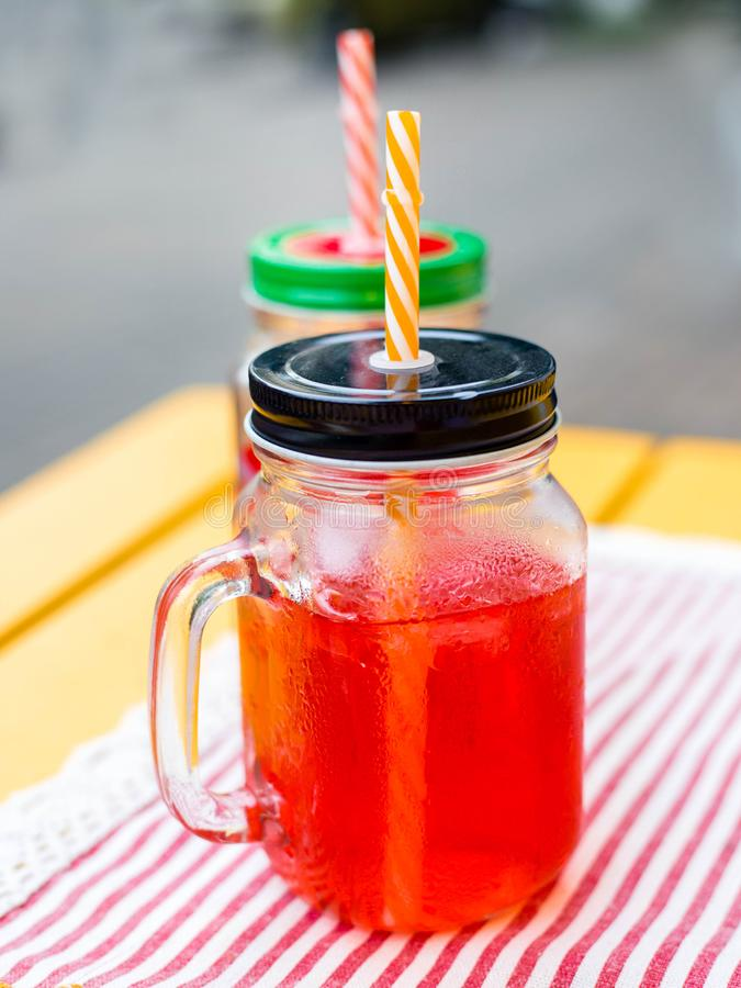 Summer homemade red currant lemonade in a mason jar on ligth wooden table. Close up. royalty free stock photos