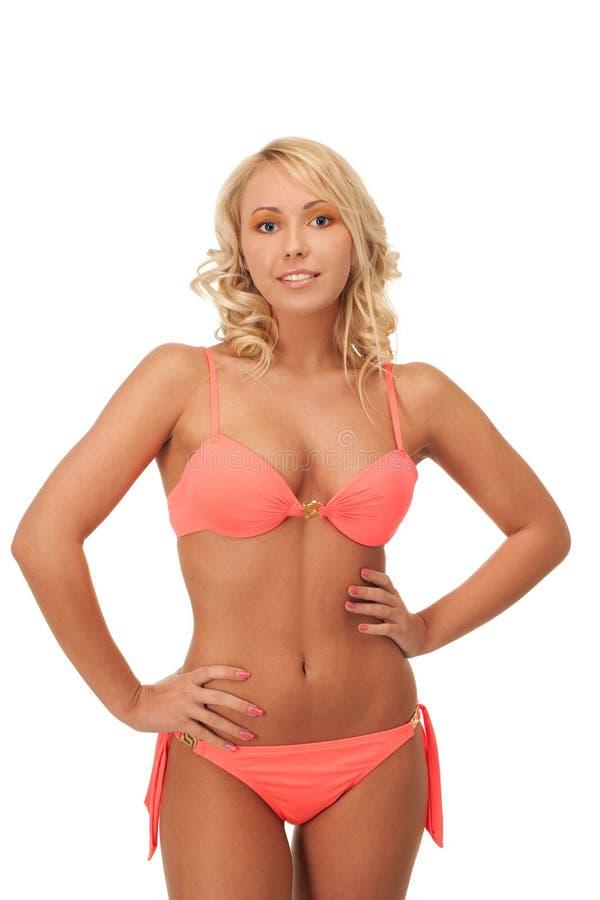 Summer hot. Beautiful blondie in pink bikini royalty free stock photo