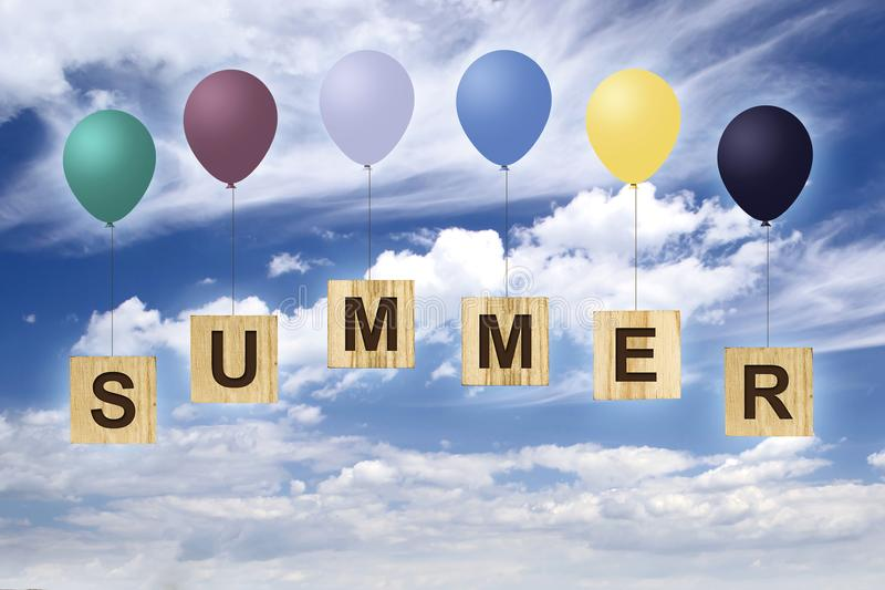 Summer. The inscription on wooden cubes with multi-colored inflatable balls against the blue cloudy sky. The concept of summer hol. Idays. Summer background royalty free illustration
