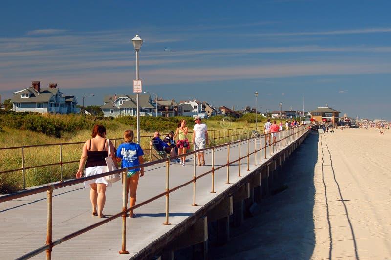 Summer on the Jersey Shore Boardwalk. Folks enjoy a summer`s day on the boardwalk in Spring Lake, New Jersey stock photos