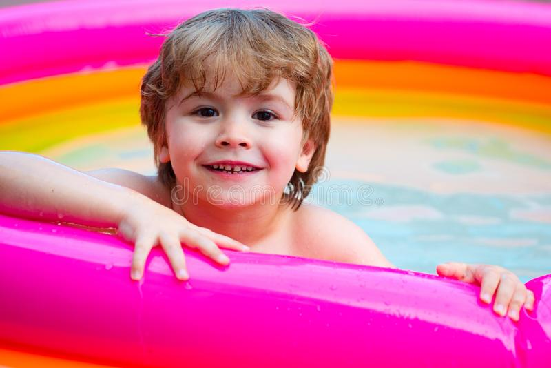 Summer kid. Happy face. Summer pool for children. Happy boy relax. Holidays in water. royalty free stock photos