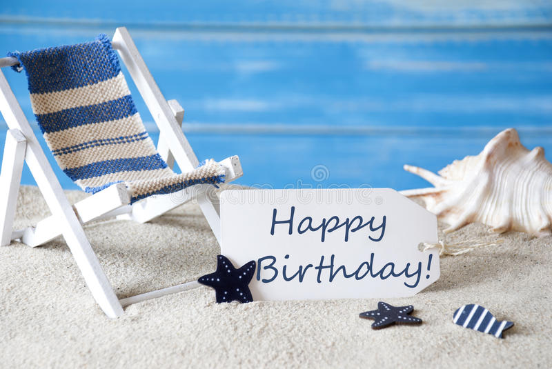 Summer label with deck chair and text happy birthday stock image summer label with english text happy birthday blue wooden background card with holiday greetings beach vacation symbolized by sand deck chair and shell m4hsunfo
