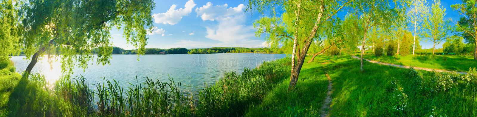 Summer lake panorama view over blue sky royalty free stock photography