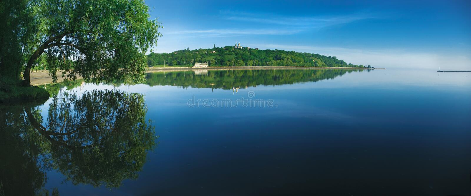Summer landscape. Green trees reflected in the Dnieper river near the Kiev city royalty free stock photo