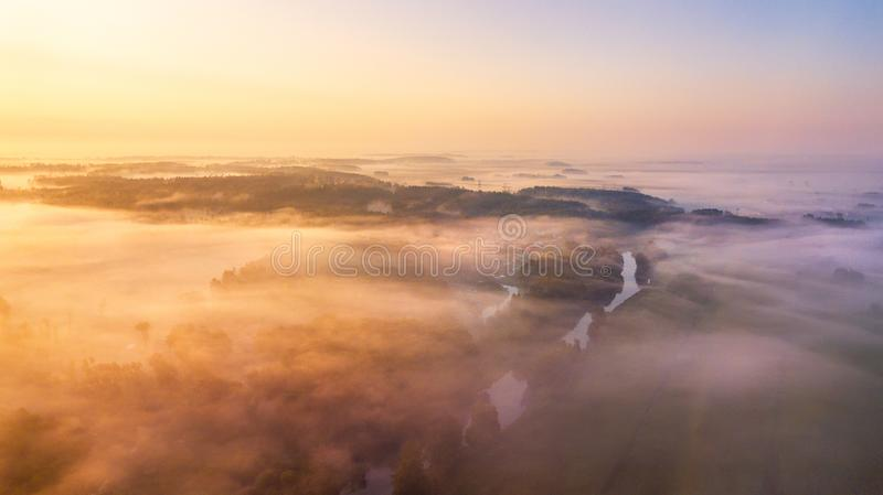 Summer landscape aerial panorama. Morning fog over river royalty free stock photos
