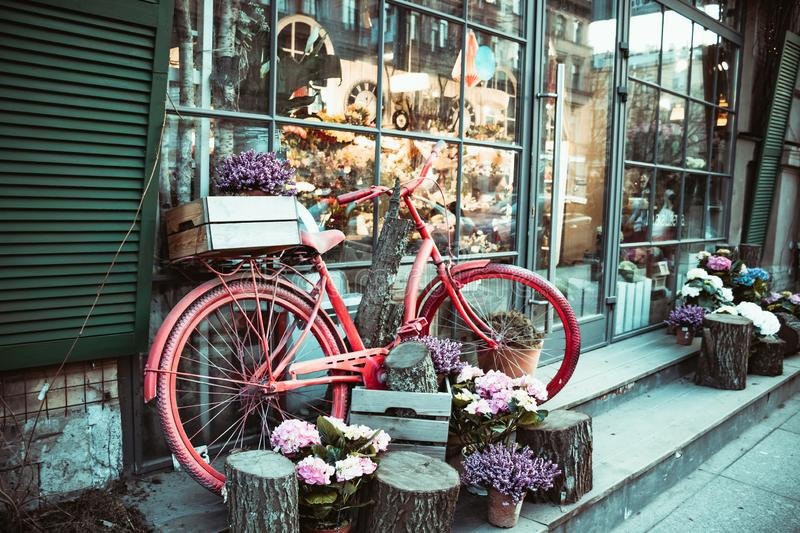 Urban bike parked to a flower shop stock images