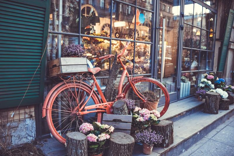 Urban bike parked to a flower shop stock photography