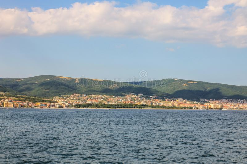 Summer landscape of the city and sea with mountains. Shadows and blue water with sky and white clouds. Sveti Vlas in Bulgaria on t. He horizon. Vacations and royalty free stock photos