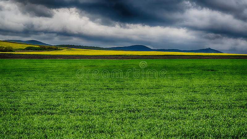 Dramatic landscape with dark and stormy clouds royalty free stock photography