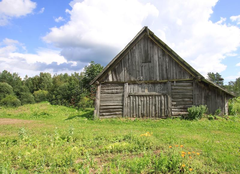 Summer landscape in the countryside in Latvia, East Europe. Old wooden shed. royalty free stock images