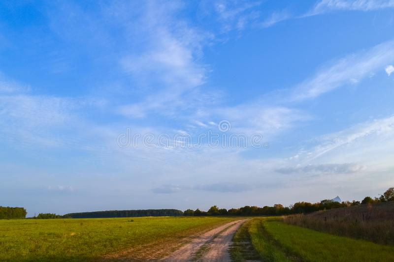 Summer landscape. Field and sky with clouds. Russia. Evening royalty free stock images
