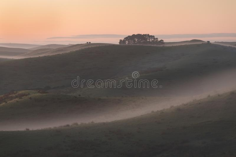 Summer landscape with fog in valley above river, foggy morning. Landscape of fields with grass in the morning. Empty pasture stock photography