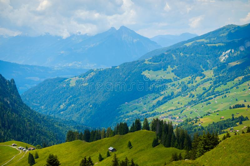 Summer landscape of green hills an mountain village royalty free stock photography
