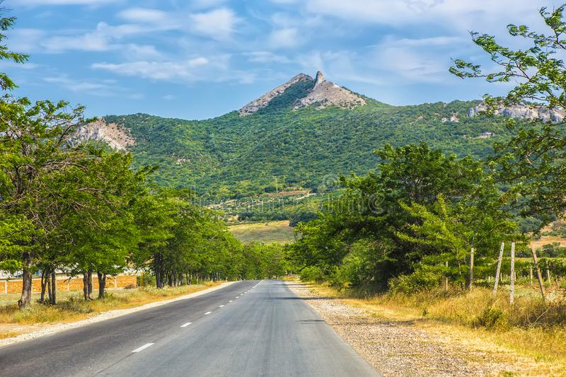 summer landscape of highway in mountainous area stock photos