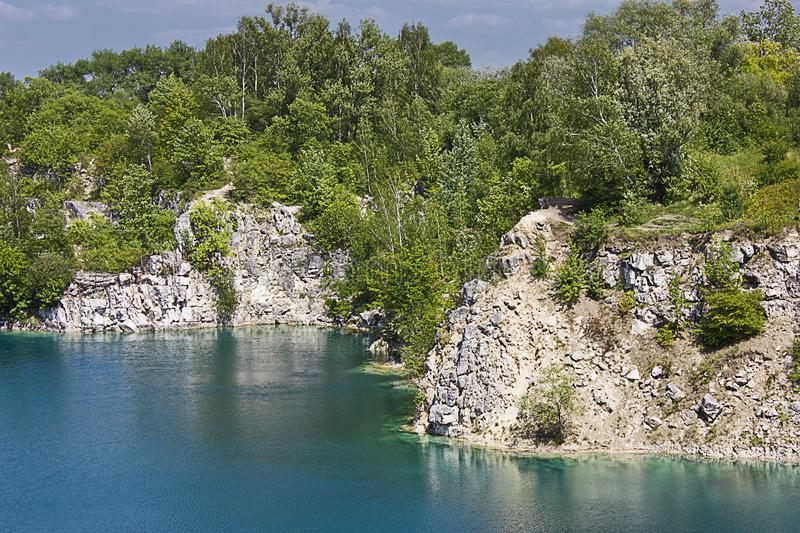 Summer landscape lake. With turquoise water among rocky coasts royalty free stock images