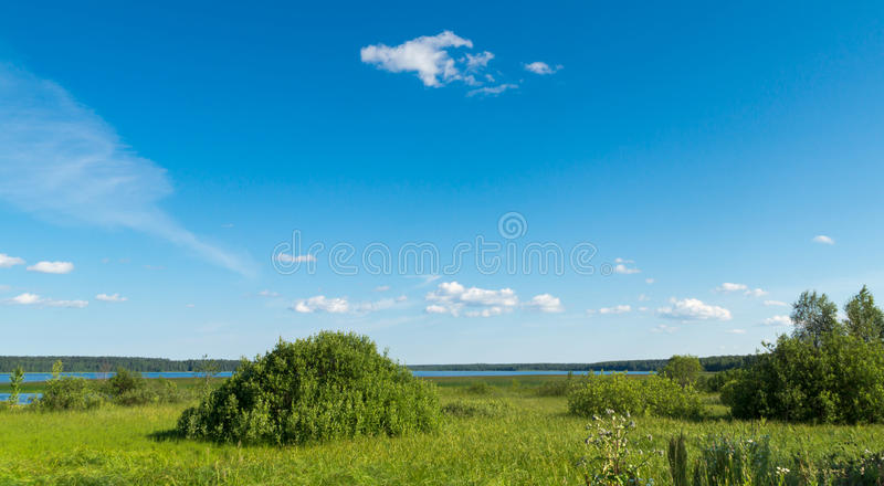 Summer Landscape Of Meadow Lake And Sky Stock Photo