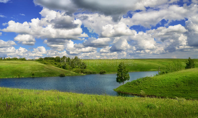 Summer landscape with river and meadows. At sunny day royalty free stock photo