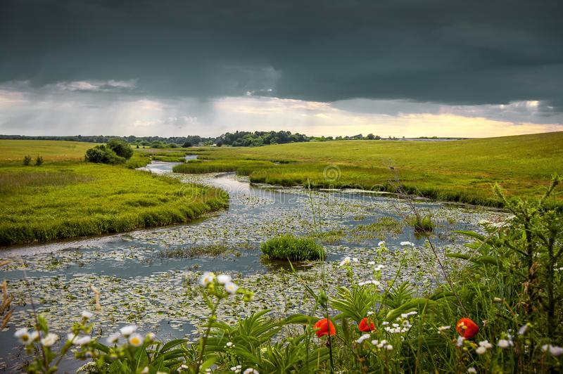 Summer landscape with a river and thunderclouds, open countryside_. Summer landscape with a river and thunderclouds, open countryside stock images