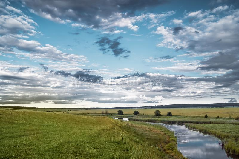 Summer landscape with a river and thunderclouds, open countryside_. Summer landscape with a river and thunderclouds, open countryside stock photos