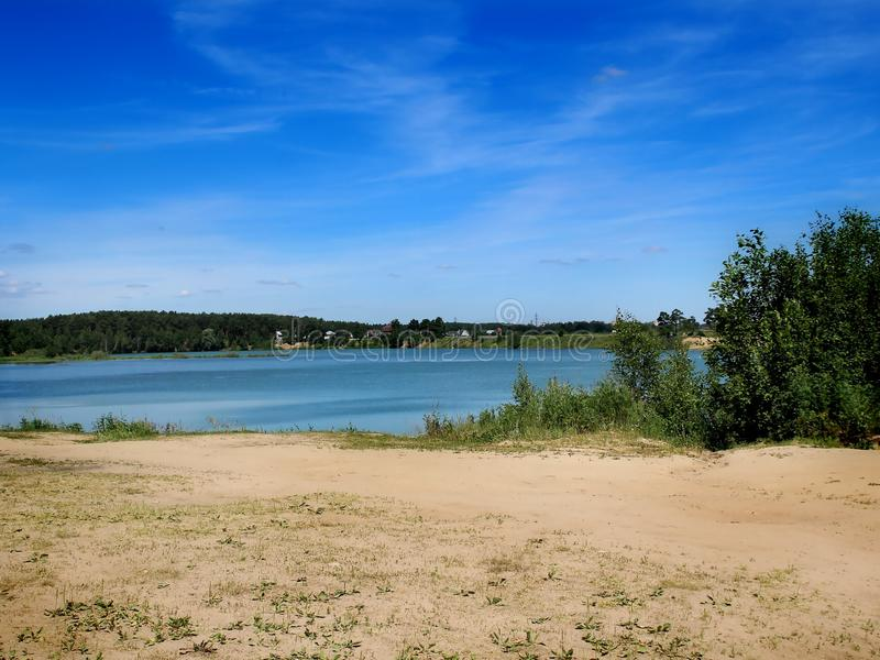 Summer landscape. Summer rural landscape - water, trees and blue sky royalty free stock image
